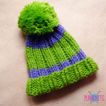 Сиренево-зелёная вязаная шапка Орбиталь с помпоном