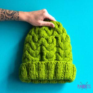 Зеленая вязаная шапка с косами ручной работы